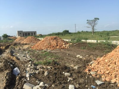 Roadside full plots at Dawhenya